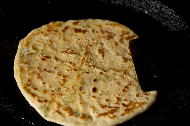 frying stuffed kulcha - paneer kulcha recipe