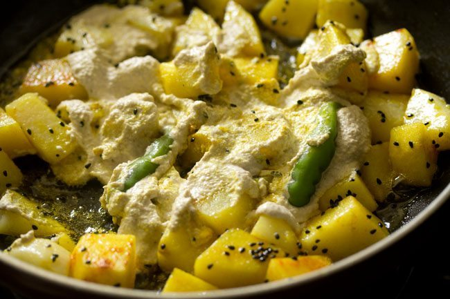 preparing aloo posto recipe