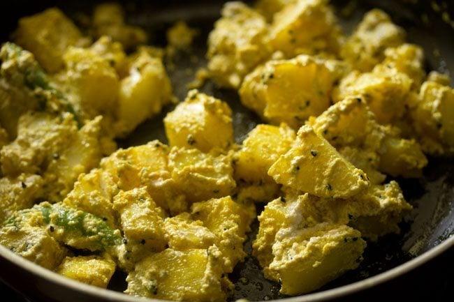 preparing aloo posto recipe