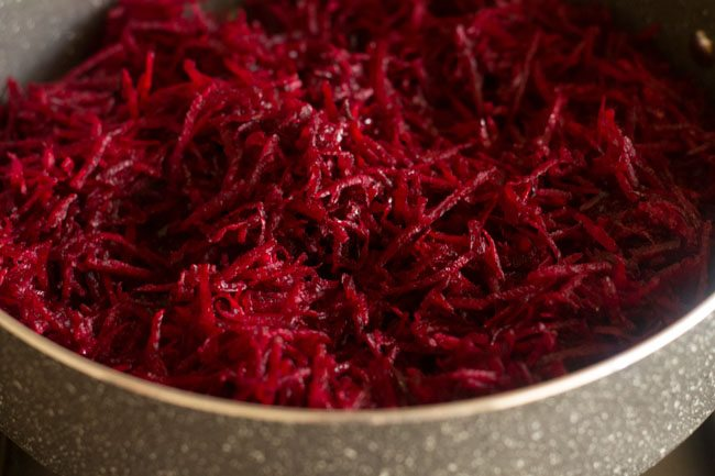 sauteing and stirring the grated beetroots