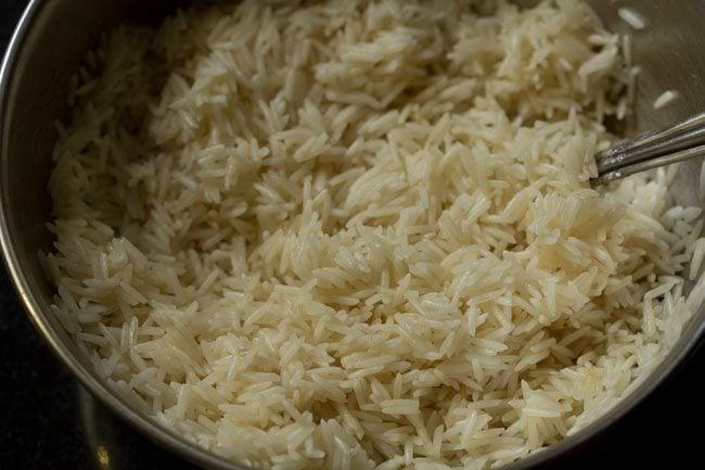 preparing paneer biryani in pressure cooker recipe