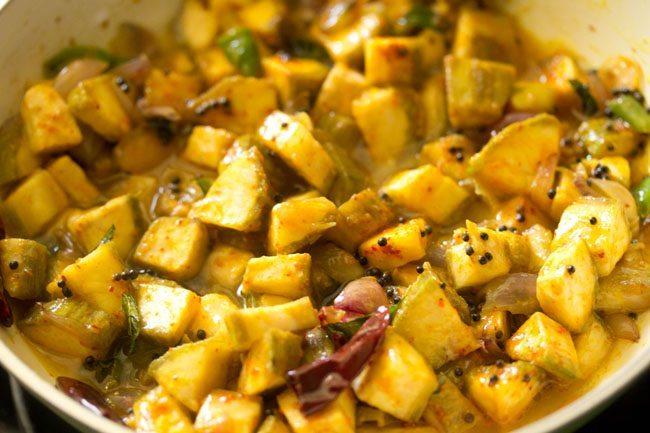 making kerala style raw banana stir fry recipe