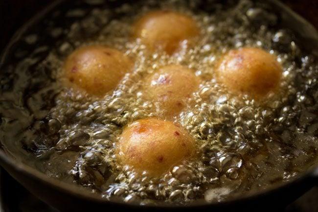 frying jamun - sweet potato gulab jamun recipe