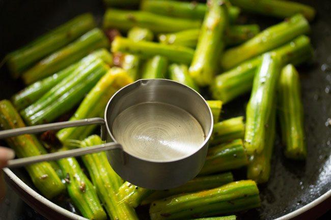 preparing drumstick sabzi recipe