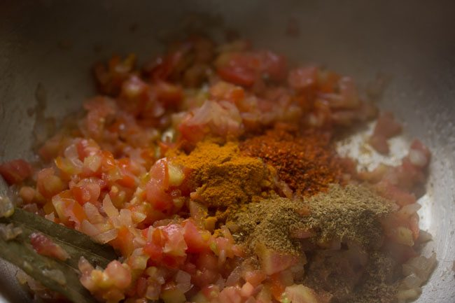 ground spices on the chopped tomatoes