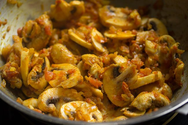 button mushrooms mixed with the onion and tomato masala