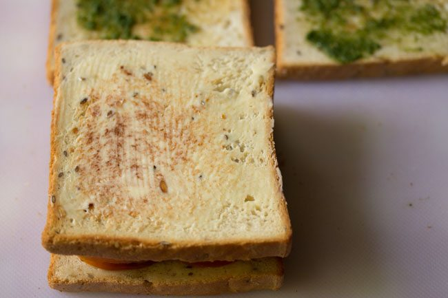 preparing veg club sandwich recipe