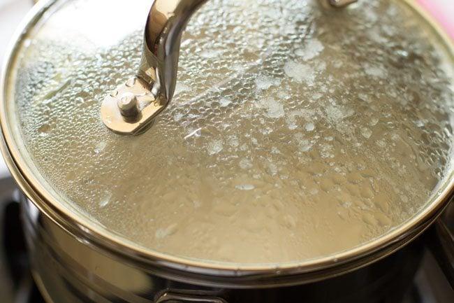 preparing restaurant style dum aloo recipe