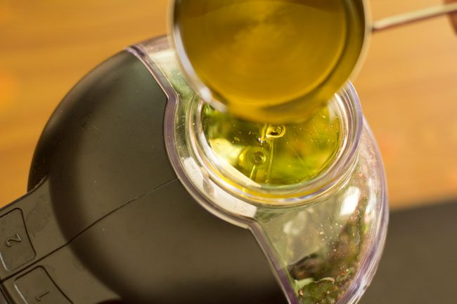 extra virgin olive oil being added in parts