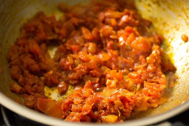 ground spices mixed with tomatoes