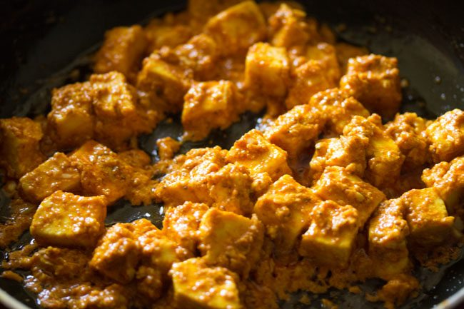 frying paneer cubes for making paneer kathi roll recipe