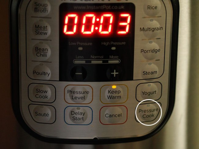 press the pressure cook button of instant pot
