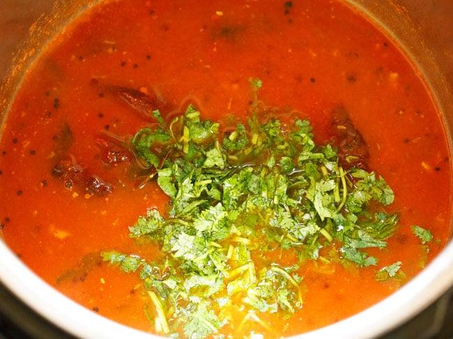 coriander leaves added to tomato rasam
