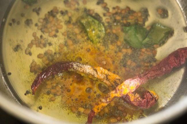making easy tomato rasam recipe