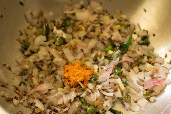 preparing schezwan masala dosa recipe