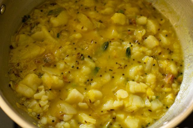 making stuffing for schezwan masala dosa recipe
