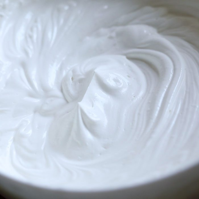 close up shot of whipped cream with stiff peaks in it for making mango ice cream from scratch