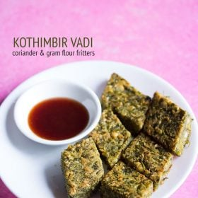 kothimbir vadi served in a white plate with sauce in a small bowl