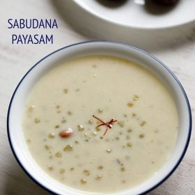 javvarisi payasam served in a white colored blue rimmed bowl with 3 saffron strands in the center