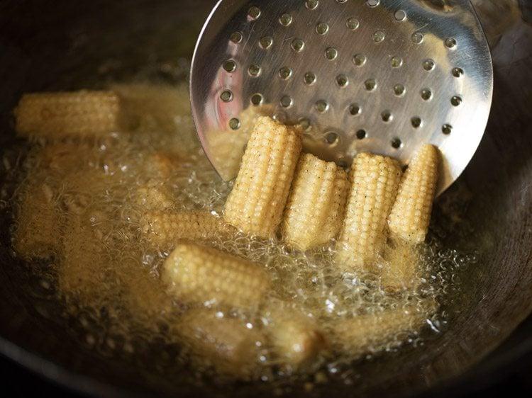 frying baby corn to make baby corn manchurian gravy recipe
