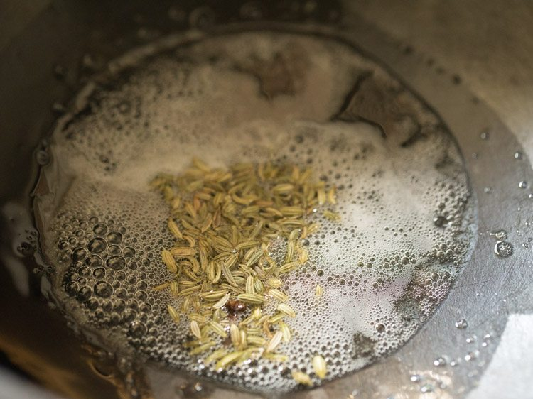 top shot of oil and seeds heating in saucepan