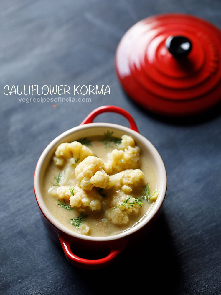 top shot of cauliflower with fresh herbs in kurma gravy, served in small red bowl with a text layover