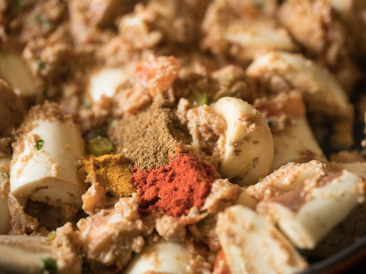 ground spices added to eggplant curry mixture in skillet.