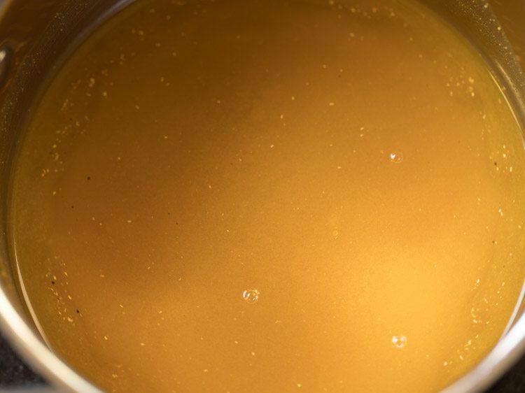 making coconut milk rasam recipe