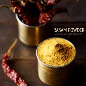rasam powder in a brass container