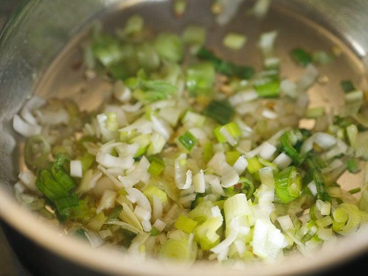 adding spring onion whites