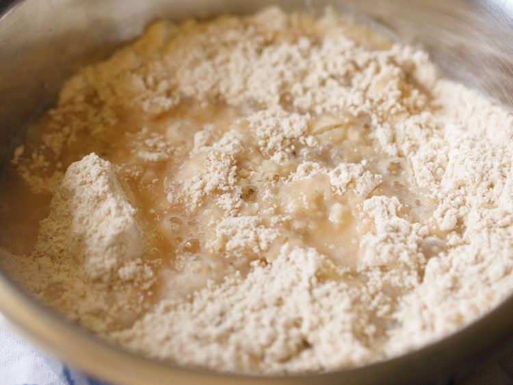 adding hot boiling water in parts to the flour