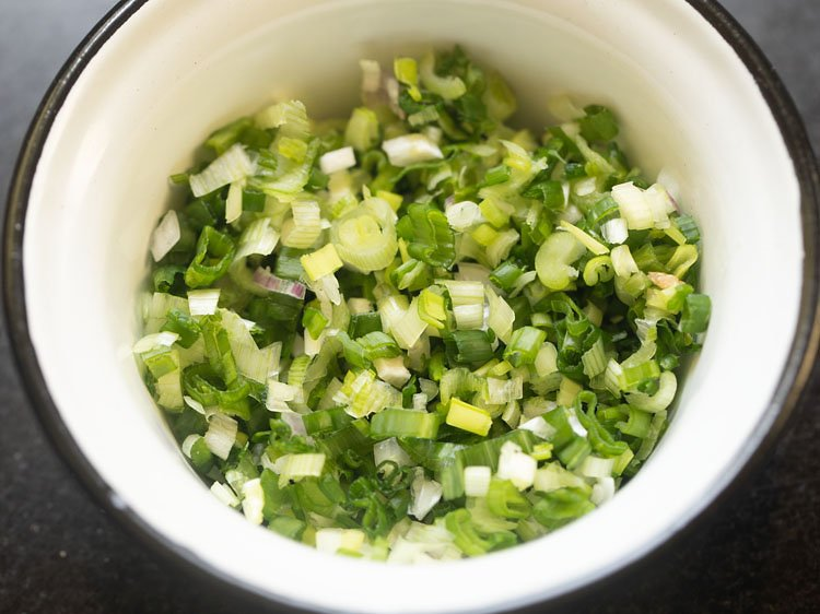 finely chopped scallions in a bowl