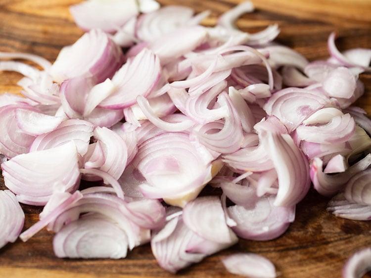 sliced onions on a chopping board