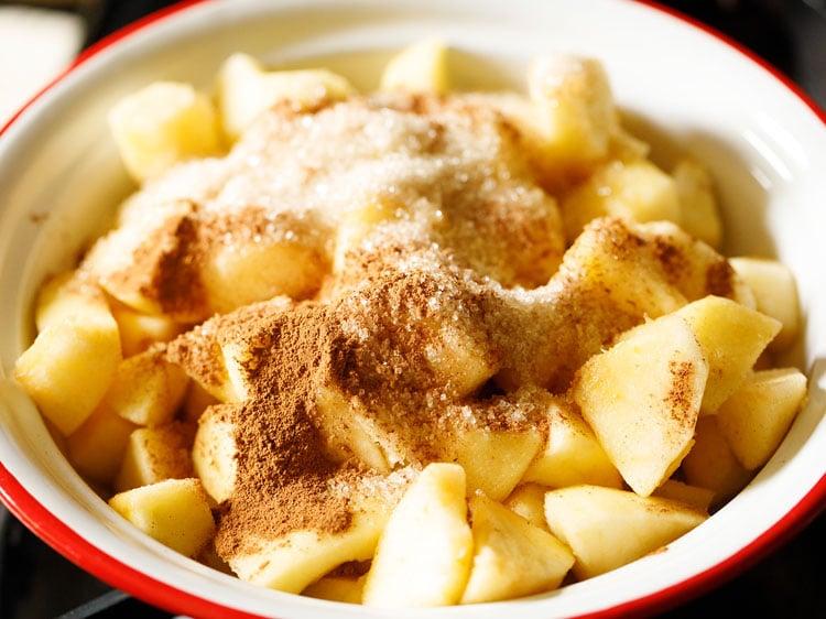 ground cinnamon, nutmeg, sugar added to chopped apples