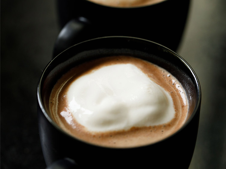 topping hot chocolate with whipped cream