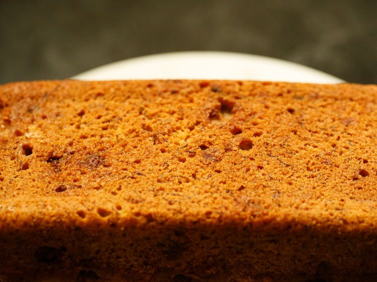 removing chocolate chip banana bread from pan