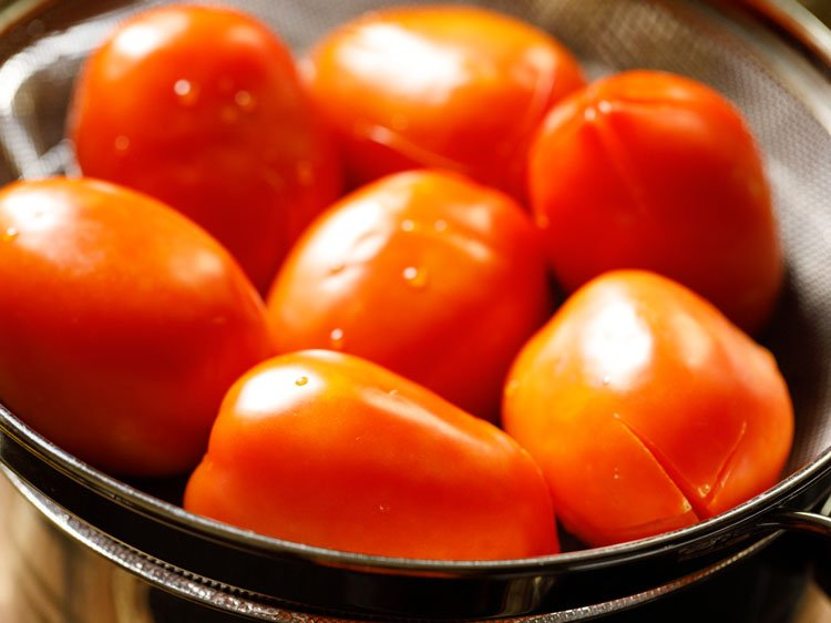 straining the tomatoes