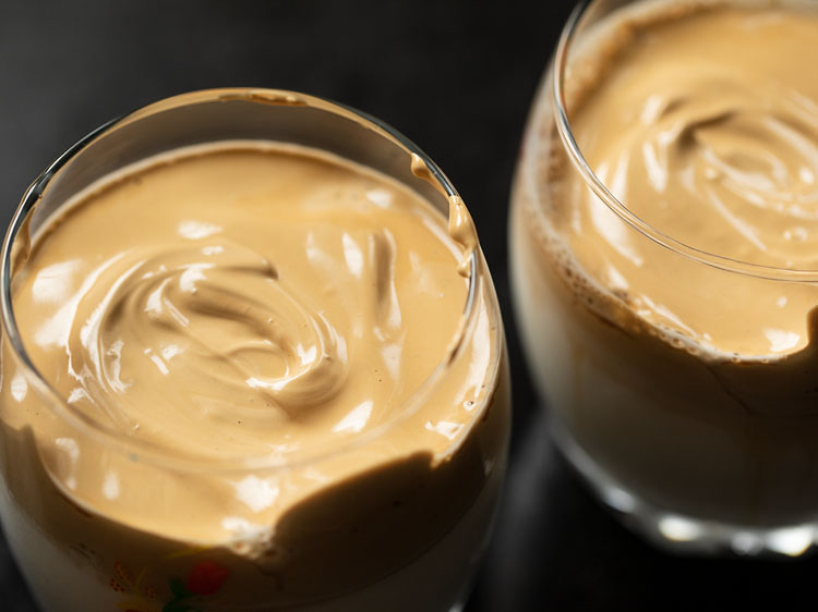 topped the glasses with foamy and creamy whipped coffee