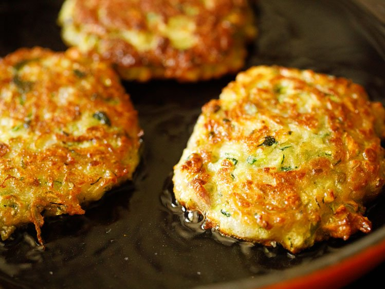 zucchini fritters cooked till both sides are golden and crisp