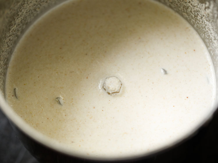 coconut paste in a spice grinder for making moru curry or pulissery recipe