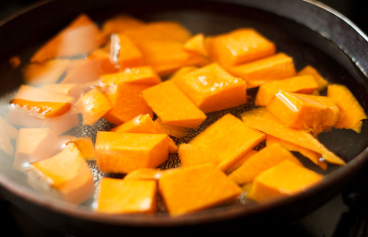 pumpkin cubes in a stockpot with water