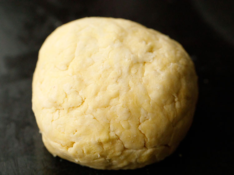 pie crust dough pressed together into a small ball shape to rest