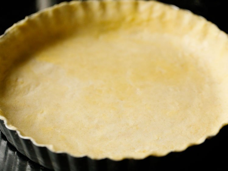 homemade all butter pie crust recipe pressed into a fluted pie tin