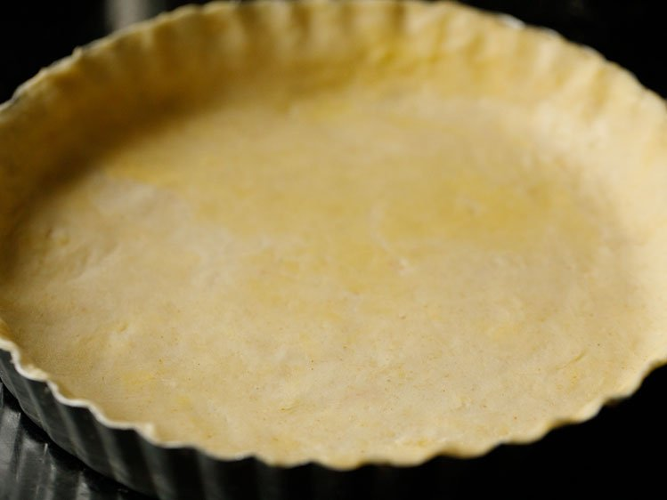 unbaked pie crust pressed into a fluted pie tin