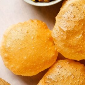 poori placed on parchment paper