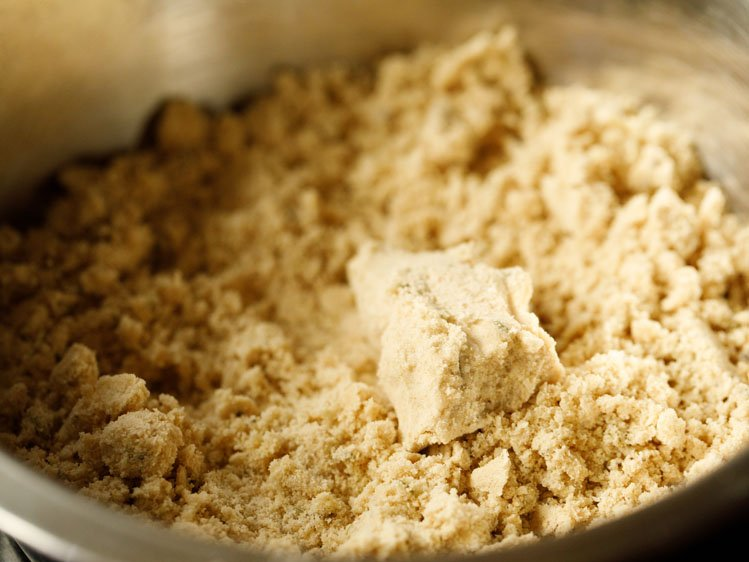 ghee and flour mixed together to a breadcrumb/sand consistency, and a piece of dough showing that the dough holds together when pressed