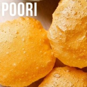 golden fried poori placed on white parchment paper