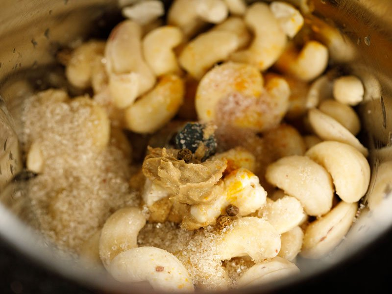 soaked raw cashews, salt, pepper, mustard, and turmeric in the bowl of a blender