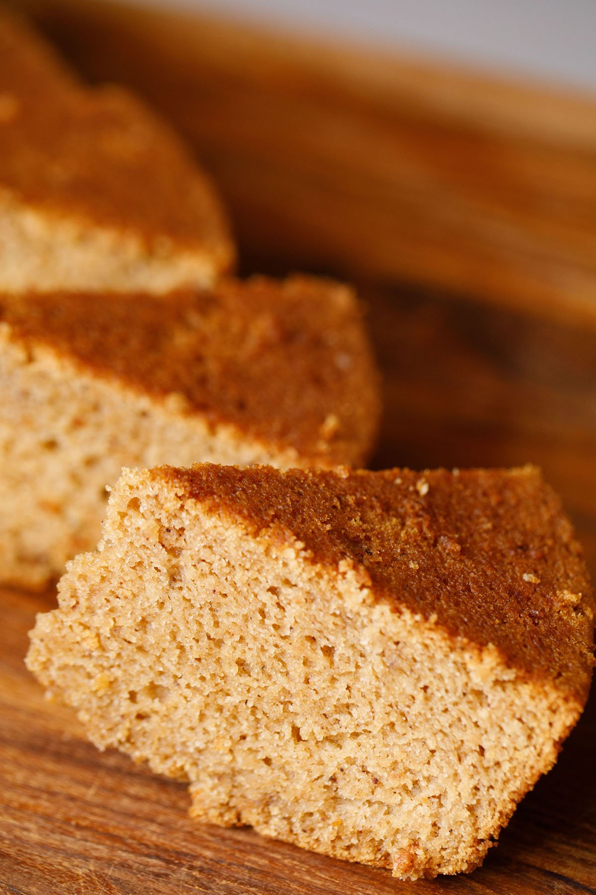 45 degree angle shot of triangular apple cake wedges showing the soft crumb