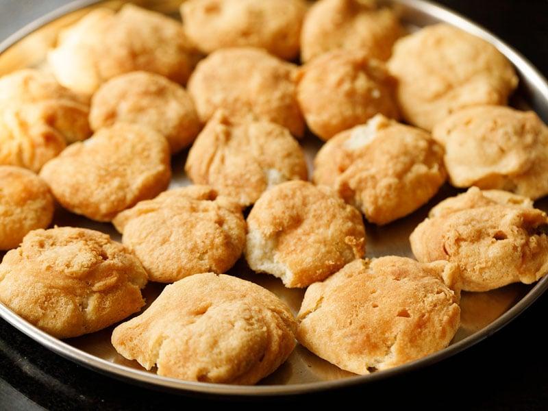 tray of dumplings or vada on a steel plate